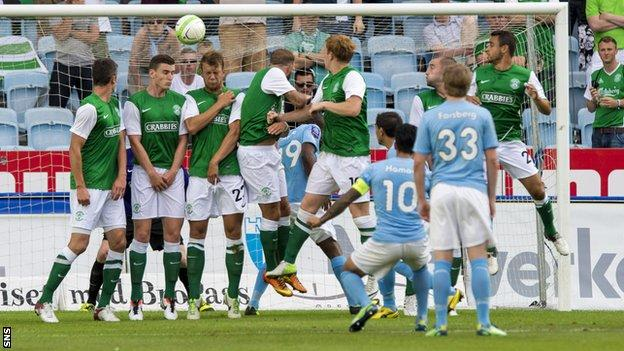 Jiloan Hamad curls the ball over the wall and past Hibernian keeper Ben Williams to give the home side the lead