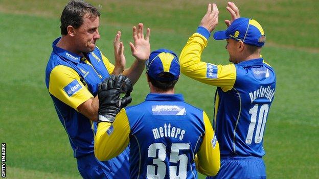 Rikki Clarke takes a wicket for Warwickshire