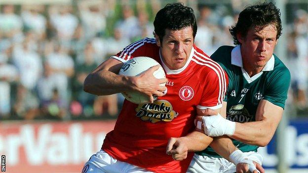 Emmet Bolton challenges Sean Cavanagh at Newbridge