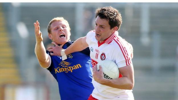 James McEnroe is shrugged off by James Kielt during the All-Ireland third round qualifier Ulster derby