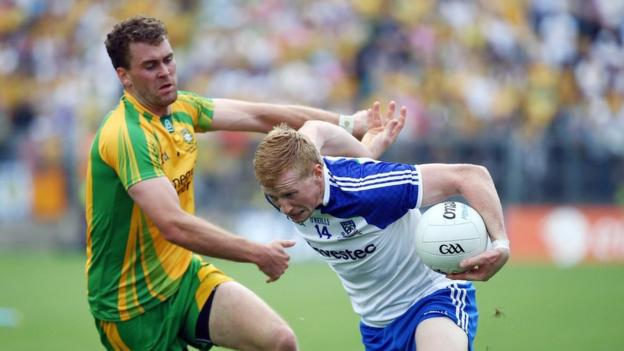 Donegal's Eamonn McGee attempts to halt the progress of Monaghan's Kieran Hughes at Clones