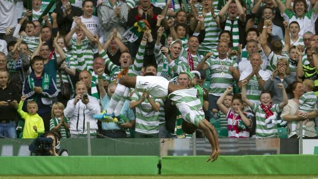An acrobatic celebration from Efe Ambrose after his goal against the Belfast visitors