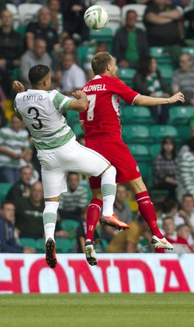 Cliftonville midfielder Ciaran Caldwell rises highest to beat Emilio Izaguiree to the ball