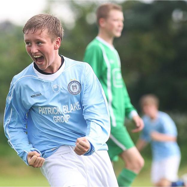Enniskillen Town's Pauric Kettyles celebrates scoring a goal in the Under-15 match against Shankill Youth