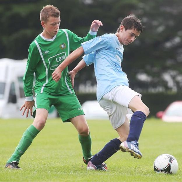 Shankill's Kyle Ferguson contests possession against Nathan Beckett of Enniskillen Town
