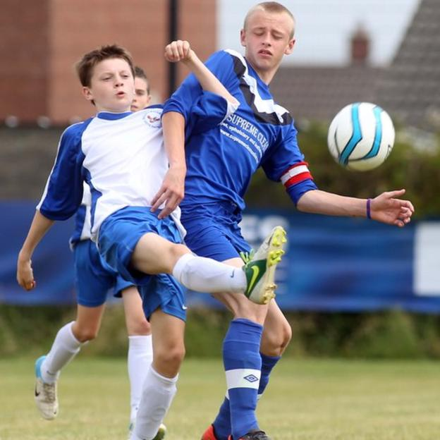Ballinamallard's Angus Keys competes against Ballymoney's Ryan McCloy in an Under-14 group fixture