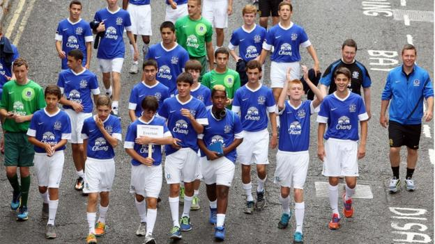 The Everton players in jovial spirit as the parade makes its way through Londonderry before the opening ceremony for the 2013 Foyle Cup