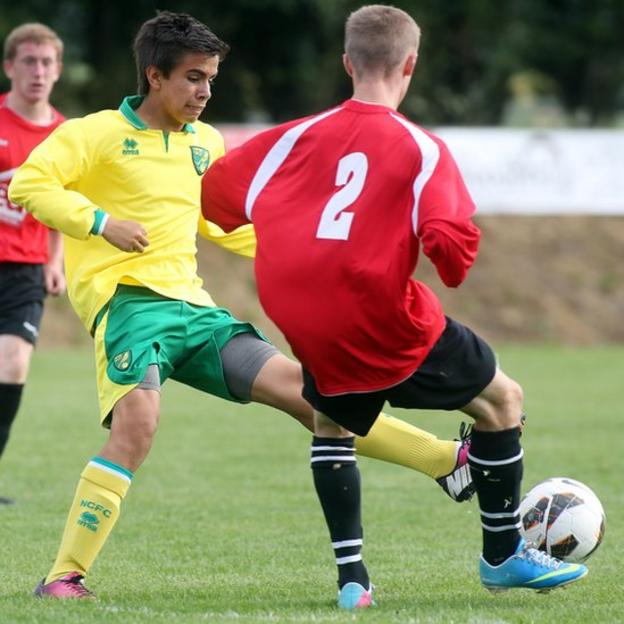 Norwich's Fernando Bell-Toxtle challenges Derry opponent Travis Hetherington during an Under-15 group fixture