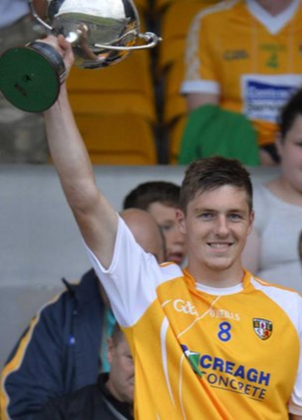 Antrim captain Jackson McGreevy lifts the cup after the win over Derry