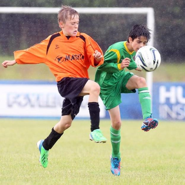 Inishowen's Pat Loughrey and Jonah Serrinah of Donegal Schools in action during an Under-13 section quarter-final