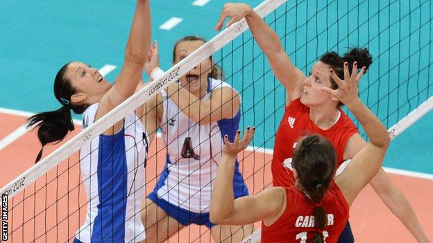 Lucy Wicks (in red) strikes at the net for Team GB in the 2012 Olympics