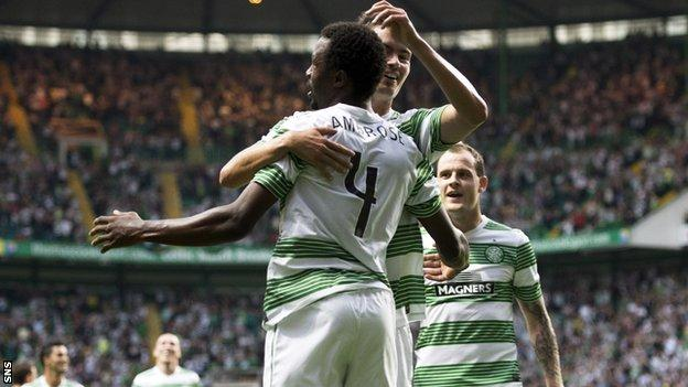 Efe Ambrose celebrates his goal against Cliftonville