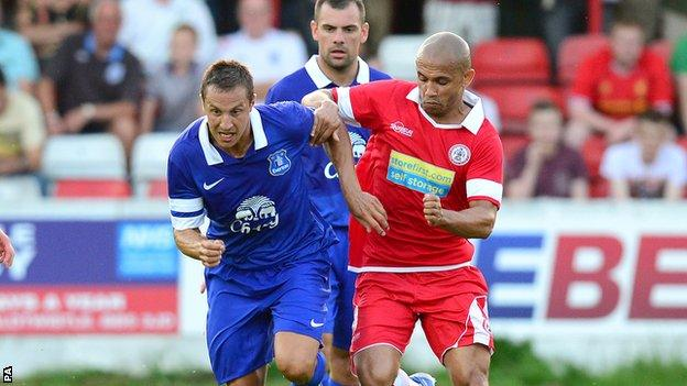 Danny Webber (right) jostles with Everton's Phil Jagielka in a recent friendly