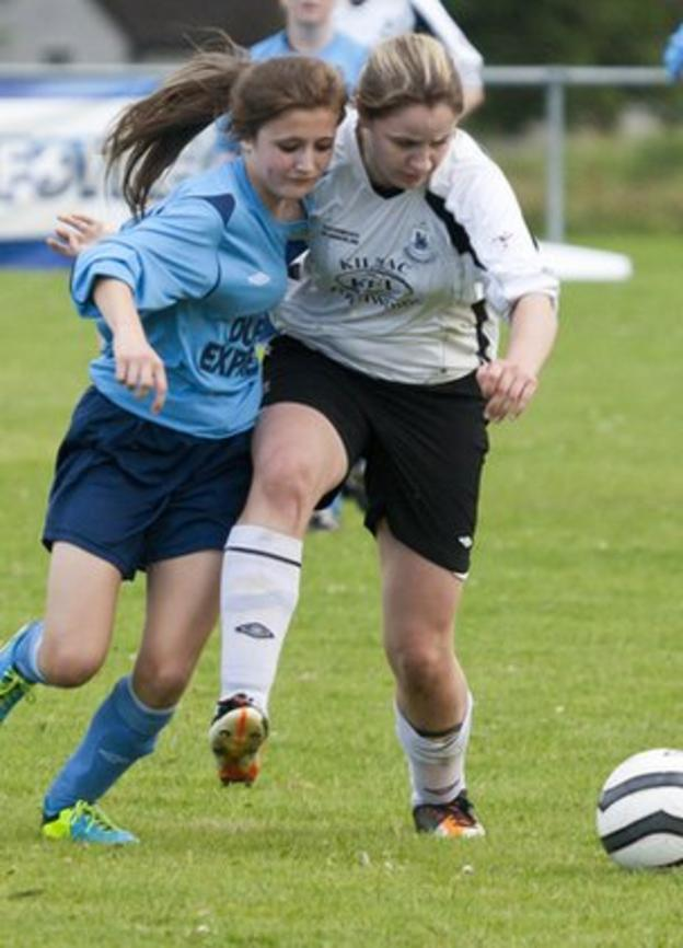 Lagan's Zoe McGlynn is challenged by Kilmacrennan's Roisin Friel in the Ladies Final at the Foyle Cup