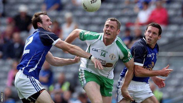 Lorcan Mulvey of London in against Cavan opponents Feargal Flanagan and Ronan Flanagan