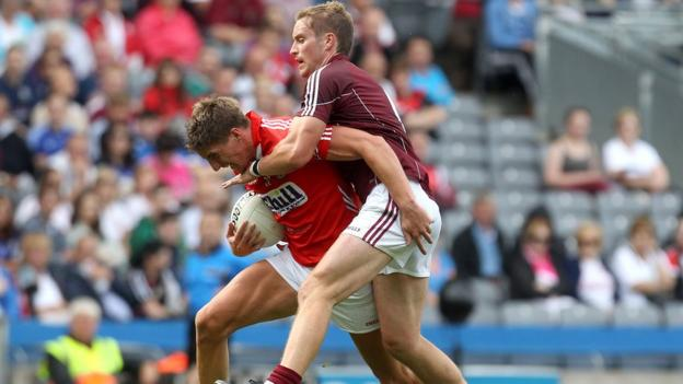 Cork's Aidan Walsh and Gary O'Donnell of Galway