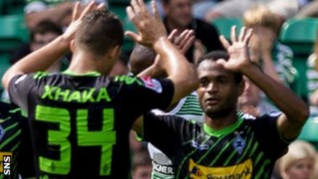 Granit Xhaka (left) celebrates scoring against Celtic