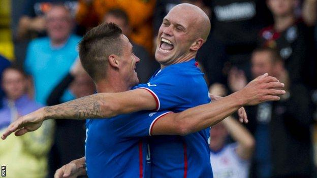Ian Black celebrates with fellow Rangers scorer Nicky Black