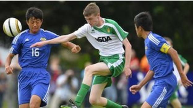 Action from Japanese FA v Co Fermanagh