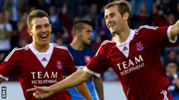 Ryan Jack and Niall McGinn celebrate for Aberdeen