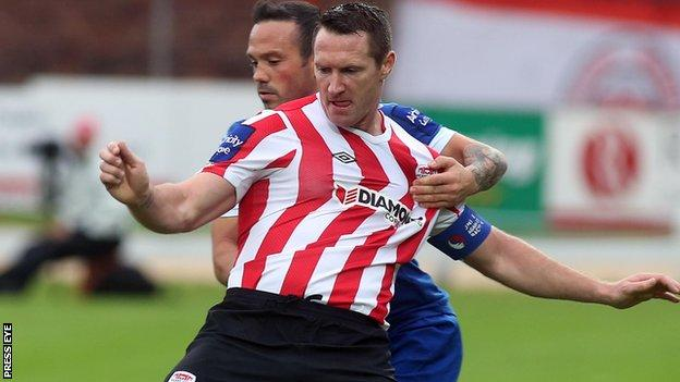 Derry's Barry Molloy is challenged by Rafael Cretaro