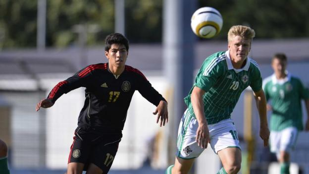 Erick Gabriel Gutierrez and Cameron McGeehan keep their eyes on the ball during the Elite Section final