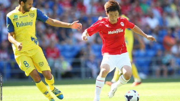 Kim Bo-Kyung takes on Chievo's Ivan Radovanovic during Cardiff City's 1-0 pre-season friendly win at Cardiff City Stadium.