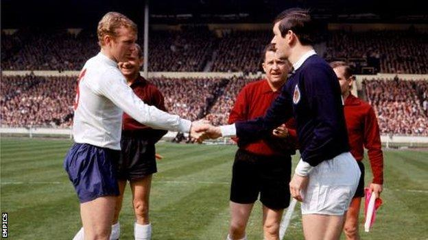 England captain Bobby Moore shakes hands with Scotland captain John Greig at Wembley in 1967