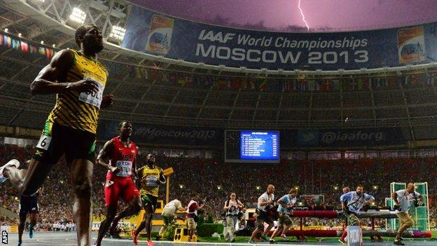 A lightning bolt in the background as Usain Bolt wins