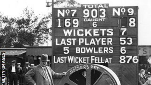 Groundsman Bosser Martin with the Oval scoreboard