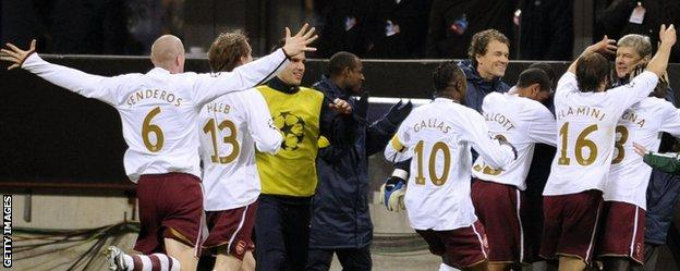 Arsenal celebrate their win at the San Siro in 2008