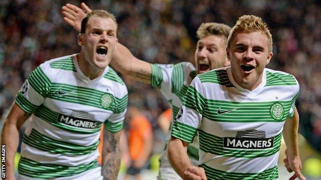 Celtic's James Forrest celebrates his late goal against Shakhter