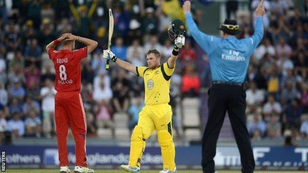 Australia's Aaron Finch (centre) celebrates bringing up his century as the umpire signals six and England bowler Stuart Broad reacts
