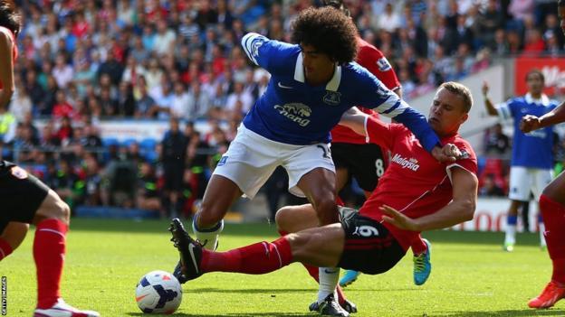 Ben Turner of Cardiff tackles Marouane Fellaini of Everton during their Premier League clash at Cardiff City Stadium
