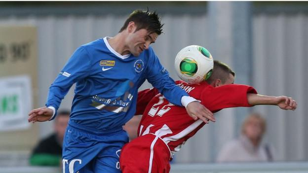 Daniel Keohane and Ruairi Devlin in action during the Premiership game at Ferney Park