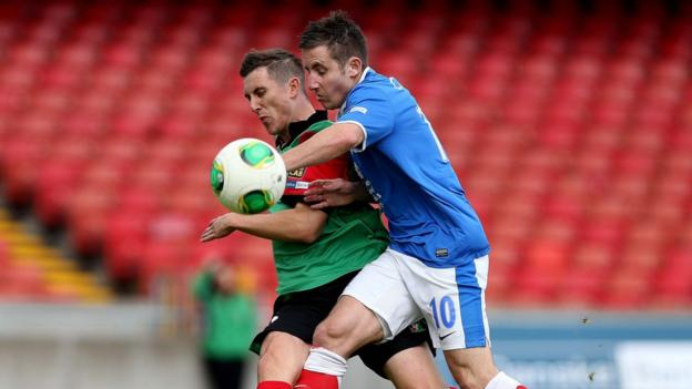 Glentoran's Marcus Kane attempts to shrug off the challenge of Linfield's Michael Carvill at Windsor Park
