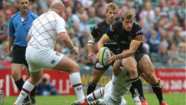 Andrew Trimble tries to break away from a Tom Croft tackle as Dan Cole looms for the Ulster winger