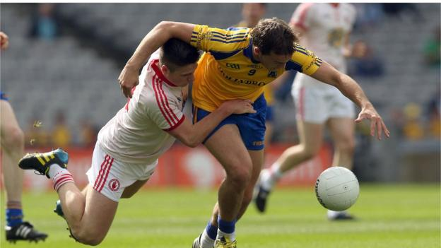 Cillian McCann gets to grips with Ultan Hanley during the All-Ireland minor semi-final