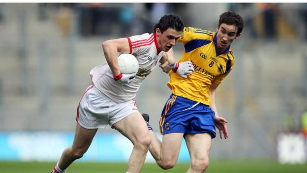 Tyrone's Ronan Nugent attempts to shrug off the attention of Roscommon's Cathal Compton