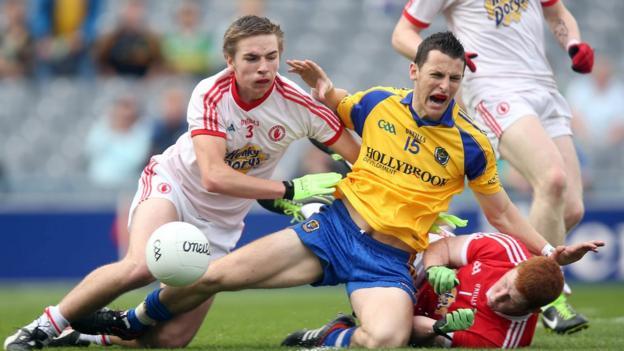 Tyrone players Rhys Quinn and Sean Fox combine to dispossess Diarmuid Murtagh in Dublin