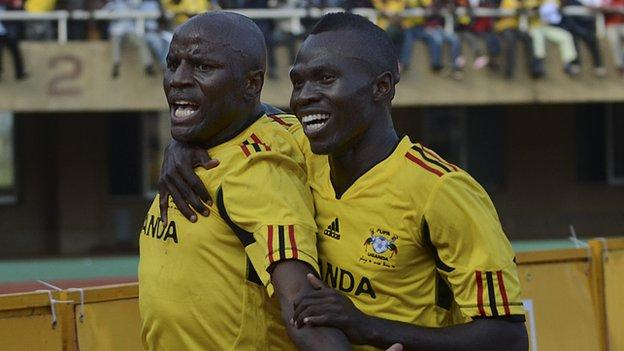 Uganda's Geoffrey Massa (left) with Emmanuel Okwi