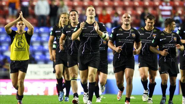 Huddersfield celebrate beating Wigan