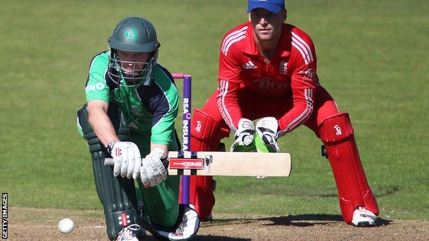 William Porterfield is about to attempt a sweep shot as England wicketkeeper Jos Buttler crouches behind the stumps