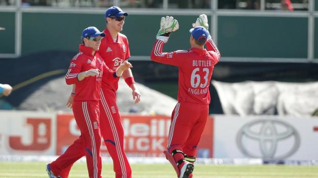 Eoin Morgan is congratulated by Boyd Rankin and Jos Butler after catching out Kevin O'Brien off the bowling of Ravi Bopara