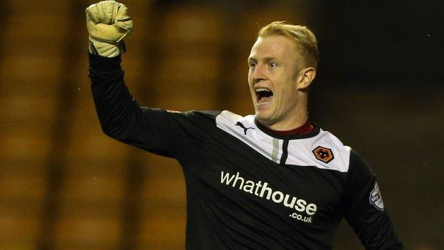 Wolves keeper Aaron McCarey celebrates one of his two penalty saves against his old club Walsall