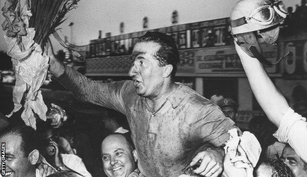 Ferrari driver Alberto Ascari is hoisted aloft by fans after winning at Monza in 1951