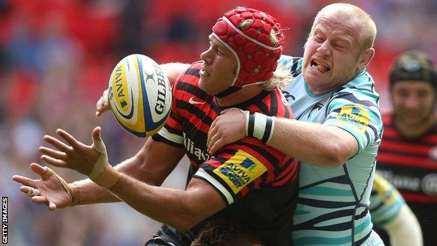 Saracens lock Mouritz Botha is tackled by Leicester prop Dan Cole