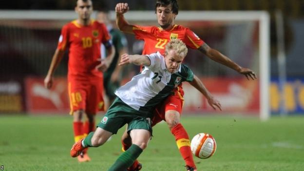 Wales forward Jonathan Williams gets involved in a midfield battle with Macedonia's Darko Tasevski