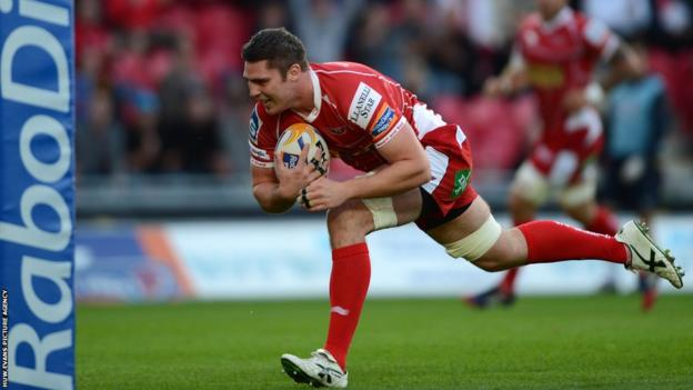 Scarlets captain Rob McCusker goes over for the first try of their season in the Pro12 against champions Leinster in Llanelli