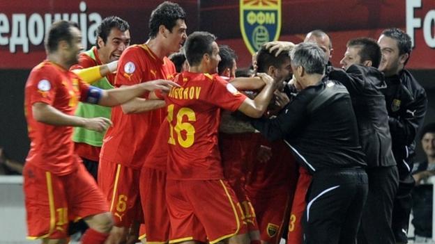 Macedonia players celebrate after Aleksandar Trajkovski's late goal secures a 2-1 victory over Wales.